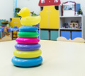 childrens toys scattered on the floor in a kindergarten - PhotoDune Item for Sale