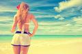 woman enjoying tropical beach relaxing joyful in summer