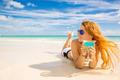 happy woman on the beach enjoying sunny weather