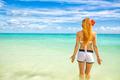 woman enjoying tropical beach relaxing