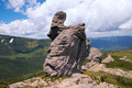 Stony figure on mountain ridge