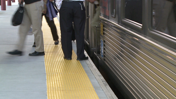 People Exiting A Commuter Train