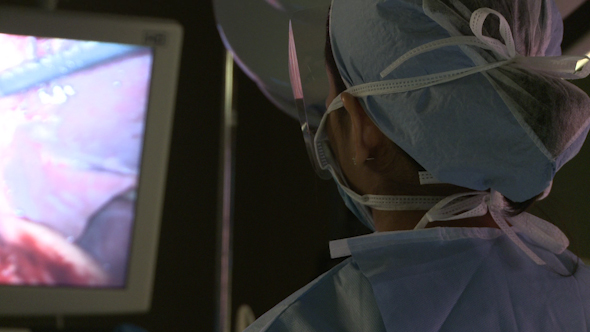 Surgeons Watch Monitor While Performing Laparoscopic Surgery 4 Of 18