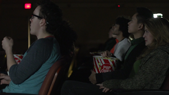Young People Watching A Movie 3 Of 7