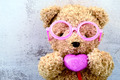 lovely bear doll wearing pink glasses and holding pink heart shape - PhotoDune Item for Sale