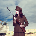 Attractive woman in army uniform carrying a rifle - PhotoDune Item for Sale