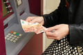 Woman Showing Withdrawn Money from the ATM - PhotoDune Item for Sale