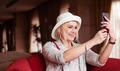 Pretty Smiling Woman Taking Selfie Photo - PhotoDune Item for Sale