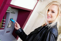 Smiling Woman Inserting a Card in an ATM - PhotoDune Item for Sale