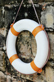 Close up Lifebuoy Hanging on Old Wall - PhotoDune Item for Sale