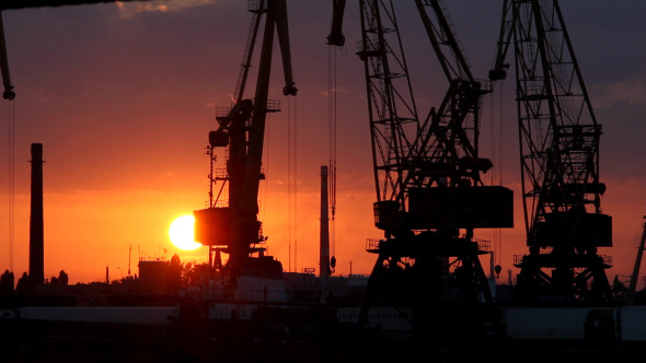A Cargo Cranes in the Port at Sunset