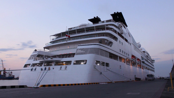 White Cruise Ship Docked in the Port