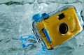 Photo of yellow waterproof camera in water with splash. - PhotoDune Item for Sale