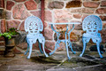 Patio furniture against stone wall - PhotoDune Item for Sale