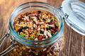 Homemade granola in open glass jar - PhotoDune Item for Sale