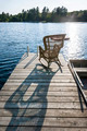 Rocking chair on small lake dock - PhotoDune Item for Sale