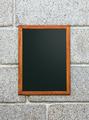Empty Restaurant Blackboard in a Stone Wall - PhotoDune Item for Sale
