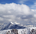 Winter snowy mountains and sky with clouds at nice day - PhotoDune Item for Sale