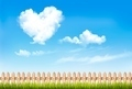 Retro nature background with blue sky with hearts shape clouds.  - PhotoDune Item for Sale