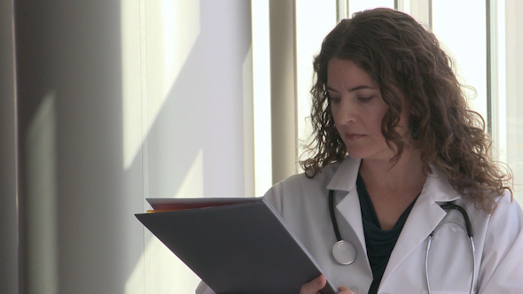 Female Doctor Turns To The Camera And Looks Confident 2 Of 2