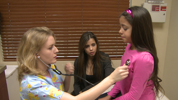Girl Has Her Lungs Checked By Nurse