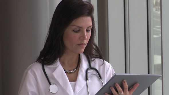 Female Doctor Early 40 s Concerned