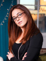 Intellectual Business Woman Wearing Glasses Head Tilted - PhotoDune Item for Sale