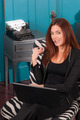 Redhead Woman Sitting Office Setting Working Computer Laptop - PhotoDune Item for Sale