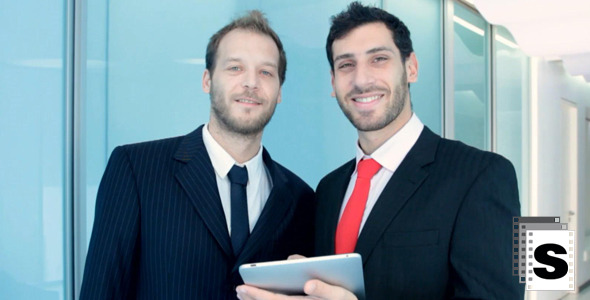 Two Businessman Working With Tablet And Smile