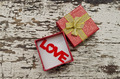 Love alphabet in gift box on grunge wood background - PhotoDune Item for Sale