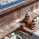 Railroad nut and bolt on background of gravel - PhotoDune Item for Sale