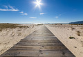 Wooden Walkway Leading to the Beach over Sand Dunes - PhotoDune Item for Sale