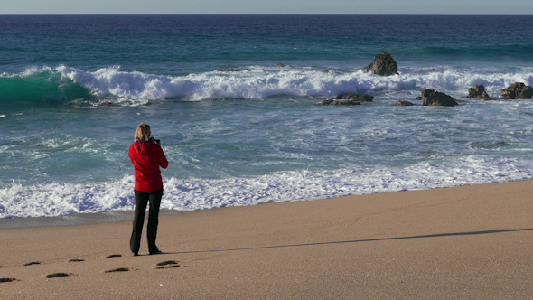 Woman Make Photo Waves in Ocean