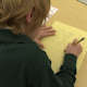Grammar School Student Doing Homework In Classroom (3 Of 6) - VideoHive Item for Sale