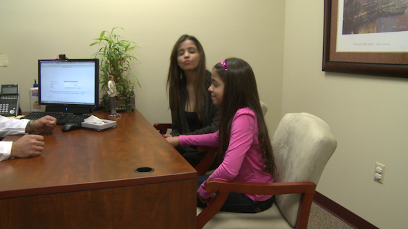 VideoHive Male Doctor Consults With Mother And Daughter 4 Of 7 10346570