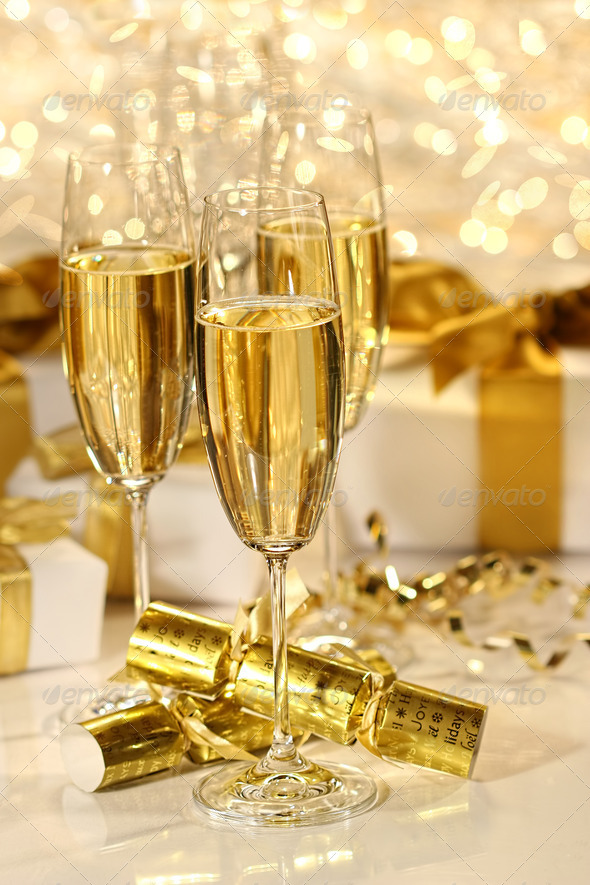 Glass of champagne against sparkle background - Stock Photo - Images