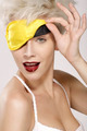 beautiful smiling model wearing a yellow sleep mask - PhotoDune Item for Sale