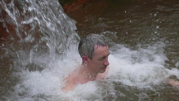 Man Taking Bath in Hot Springs