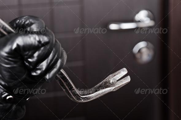 PhotoDune Burglar hand holding crowbar break opening door 1046177