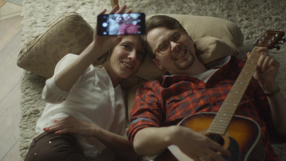 Couple are Laying on the Floor and Doing Selfie