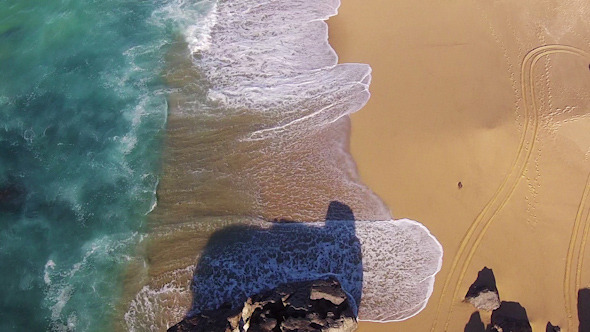 Waves Crashing on Beach Aerial View