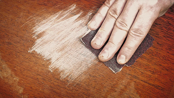 Hand Sanding A Wooden Surface