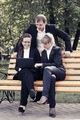 Young business people using laptop in a city park - PhotoDune Item for Sale