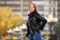 Young fashion blond woman in leather jacket on the city street - PhotoDune Item for Sale