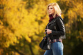 Young fashion blond woman in leather jacket in autumn park - PhotoDune Item for Sale