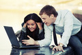 Young business couple with laptop outdoor - PhotoDune Item for Sale