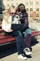 Teenage school girls using laptop on the bench - PhotoDune Item for Sale