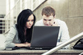 Young business couple using laptop outdoor - PhotoDune Item for Sale