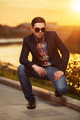 Portrait of young fashion man in sunglasses at sunset - PhotoDune Item for Sale