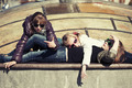 Group of teenage school girls lying on the sidewalk - PhotoDune Item for Sale